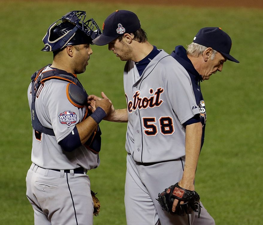 Detroit Tigers starting pitcher Doug Fister is congratulated by C Gerald Laird after being replaced during the seventh inning of Game 2 of the World Series between the Detroit Tigers and San Francisco Giants in San Francisco on Oct. 25, 2012. (Associated Press)
