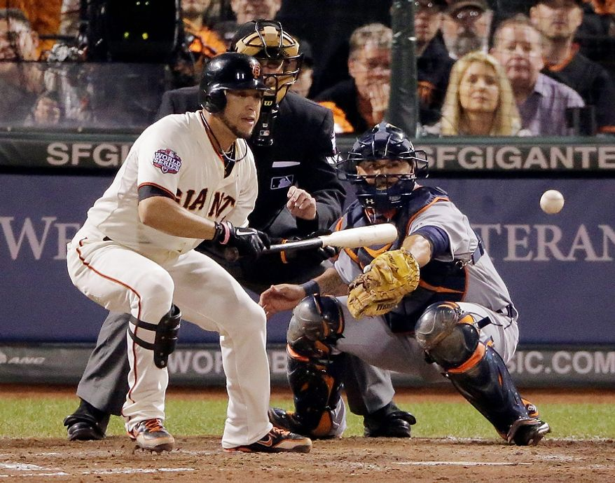 San Francisco Giants LF Gregor Blanco bunts to load the bases during the seventh inning of Game 2 of the World Series between the Giants and Detroit Tigers in San Francisco on Oct. 25, 2012. (Associated Press)