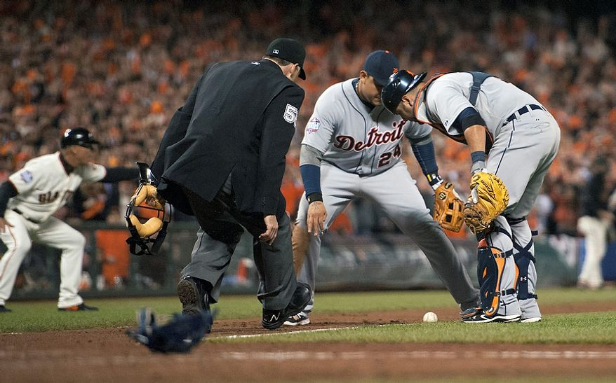Detroit Tigers 3B Miguel Cabrera (24) and C Gerald Laird (9) watch a bunt by San Francisco Giants LF Gregor Blanco during the seventh inning of Game 2 of the World Series between the Giants and Detroit Tigers in San Francisco on Oct. 25, 2012. (Associated Press/The Sacramento Bee)