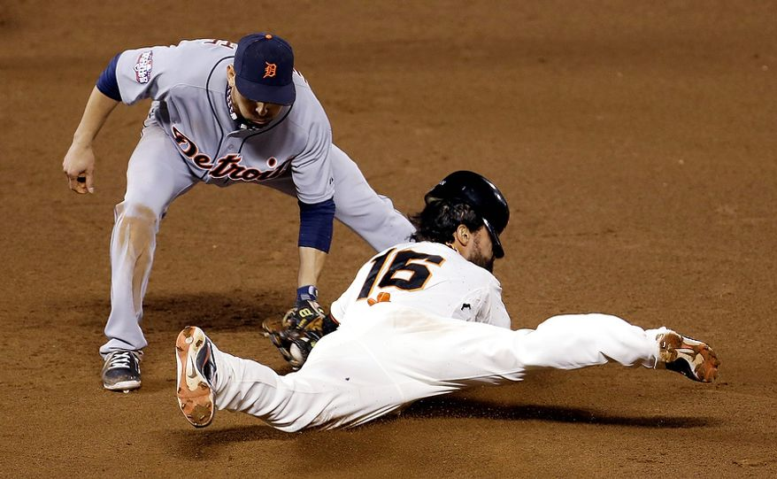 San Francisco Giants CF Angel Pagan steals second base as Detroit Tigers 2B Omar Infante applies the tag in the eighth inning of Game 2 of the World Series in San Francisco on Oct. 25, 2012. The Giants won 2-0 to take a 2-0 lead in the series. (Associated Press)