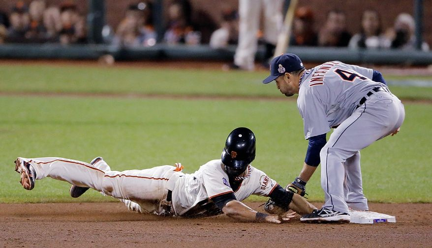 San Francisco Giants CF Angel Pagan successfully steals second base as Detroit Tigers 2B Omar Infante attempts to tag during the eighth inning of Game 2 of the World Series in San Francisco on Oct. 25, 2012. (Associated Press)