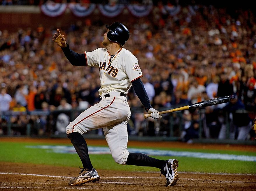 San Francisco Giants RF Hunter Pence watches his sacrifice fly that scored teammate Angel Pagan during the eighth inning of Game 2 of the World Series between the Giants and Detroit Tigers in San Francisco on Oct. 25, 2012. (Associated Press/The Sacramento Bee)