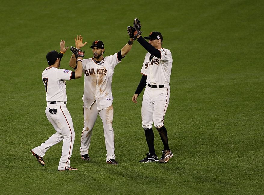 San Francisco Giants LF Gregor Blanco (left), CF Angel Pagan (center) and RF Hunter Pence celebrate after the Giants defeated the Detroit Tigers, 2-0, in Game 2 of the World Series in San Francisco on Oct. 25, 2012. (Associated Press)