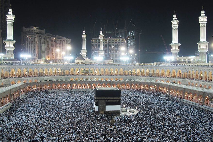 Muslim pilgrims circle the Kaaba as pray inside the Grand mosque in the holy city of Mecca, Saudi Arabia, on Oct. 23, 2012. The annual Islamic pilgrimage draws 3 million visitors each year, making it the largest yearly gathering of people in the world. (Associated Press)