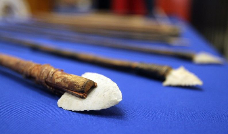 Some seized artifacts returned to Mexico are displayed on a table during a news conference at the Mexican Consulate in El Paso, Texas, on Oct. 25, 2012. More than 4,000 archaeological artifacts looted from Mexico and seized in the U.S. were returned to Mexican authorities in what experts say is one of the largest repatriation ever made between the neighboring countries. (Associated Press/The El Paso Times)