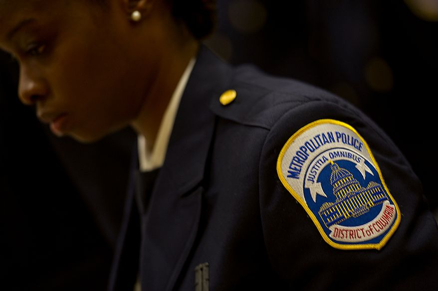 New Metropolitan Police Department Officer Juvon Gaines stands at attention during her graduation ceremony from the police academy on Oct. 26, 2012 in Southwest Washington. (Barbara L. Salisbury/The Washington Times)