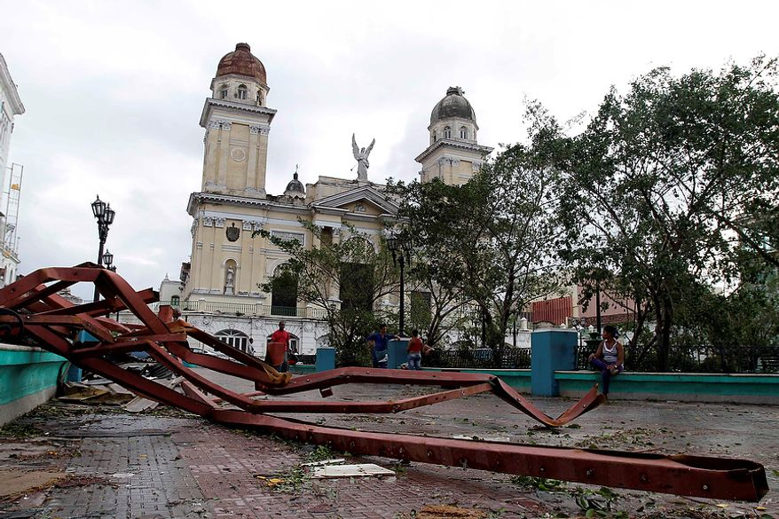 A fallen placard lies on the ground after the passing of Hurricane Sandy in Santiago de Cuba, Cuba, on Oct. 25, 2012. Hurricane Sandy blasted across eastern Cuba as a potent Category 2 storm and headed for the Bahamas after causing at least two deaths in the Caribbean. (Associated Press)
