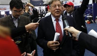 ** FILE ** Former New Hampshire Gov. John Sununu speaks to reporters in the spin room on behalf of Mitt Romney after the second presidential debate at Hofstra University, Tuesday, Oct. 16, 2012 Hempstead, N.Y. (AP Photo/Mary Altaffer)