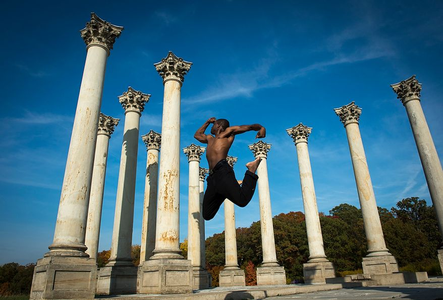 Georgetown law student Orga Cadet jumps as he poses for a photo for his girlfriend Audrey Pichy (not in photo) as they visit the Capitol Columns at the National Arboretum in Washington, D.C., Tuesday, Oct. 23, 2012. The 22 Corinthian sandstone columns were among the 24 that were part of the east central portico of the US Capitol.These columns provided the backdrop for presidential inaugurations from 1829 (Andrew Jackson to 1957 (Dwight Eisenhower) and were the site of many speeches, protests and rallies. In 1958 the columns were dismantled to make way for the east front extension of the Capitol, which is adorned with marble reproductions. Restoration of the columns was made possible through the efforts of Ethel Shields Garrett and support form the Friends of the National Arboretum. (Rod Lamkey Jr./The Washington Times)