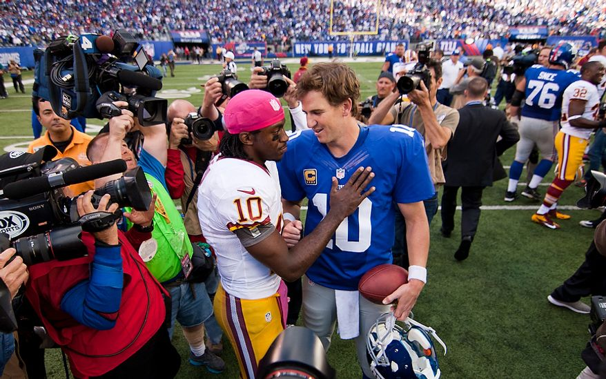 Washington Redskins quarterback Robert Griffin III (10) congratulates New York Giants quarterback Eli Manning (10) after losing 27 to 23 at Metlife Stadium, East Rutherford, N.J., Oct. 21, 2012 (Craig Bisacre/The Washington Times)
