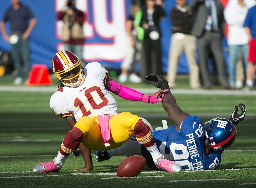 Washington Redskins quarterback Robert Griffin III (10) fumbles the ball in fourth quarter at MetLife Stadium in East Rutherford, N.J., Sunday, Oct. 21, 2012. (Rod Lamkey Jr./The Washington Times)