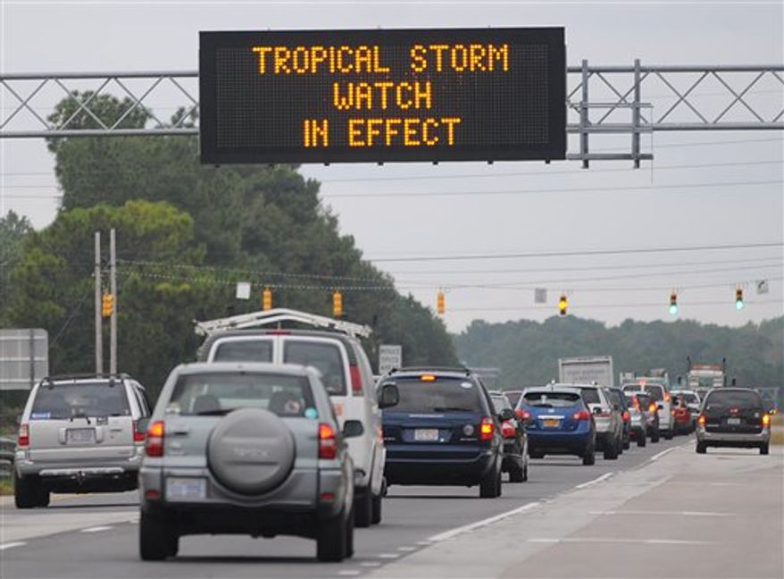 A sign on N. College Rd. in Wilmington, N.C. notifies motorists of a tropical storm watch as Hurricane Sandy churns over the Atlantic ocean, Friday Oct. 26, 2012. (AP Photo/The Star-News, Paul Stephen)