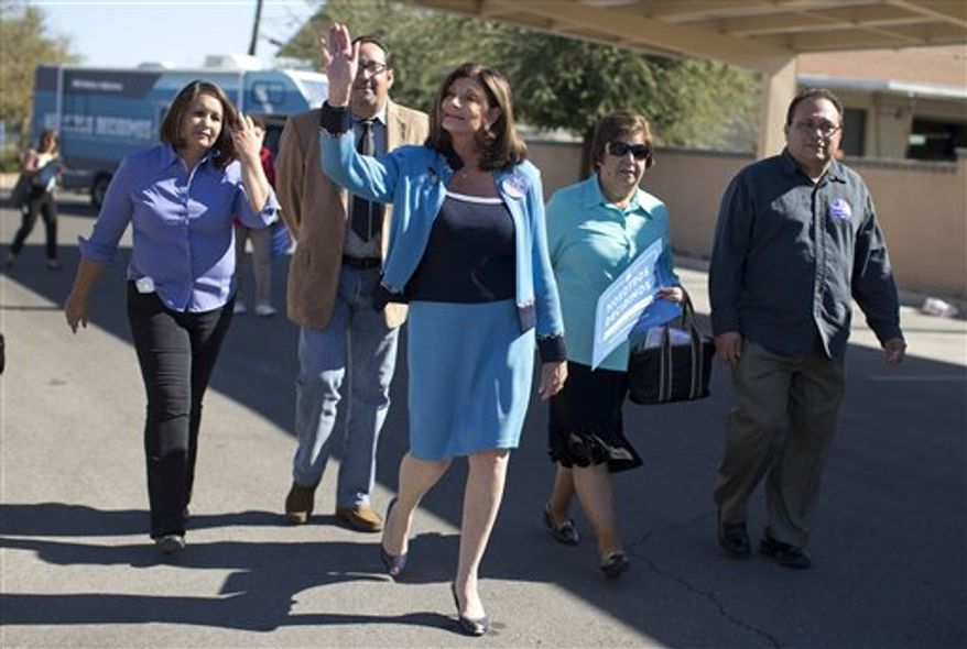 Rep. Shelley Berkley, D-Nev. heads to an early voting location to vote, Thursday, Oct. 25, 2012, in Las Vegas. Interest in this year's election is being driven by races between President Barack Obama and Mitt Romney, and U.S. Sen. Dean Heller, R-Nev., and his Democratic challenger, Berkley. (AP Photo/Julie Jacobson)