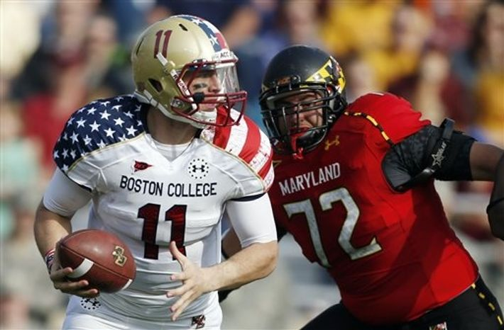 Boston College quarterback Chase Rettig (11) looks to pass under pressure from Maryland defensive lineman Joe Vellano (72) in the second quarter of an NCAA college football game in Boston, Saturday, Oct. 27, 2012. (AP Photo/Michael Dwyer)