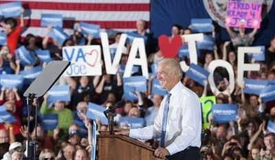 Vice President Joe Biden prepares to speak at the Lynchburg City Armory, Saturday, Oct. 27, 2012, in Lynchburg, Va. (AP Photo/News & Daily Advance, Sam O'Keefe)