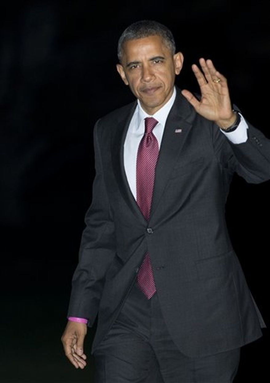 President Barack Obama waves as he arrives the White House in Washington from a campaign trip in New Hampshire, Saturday, Oct. 27, 2012. (AP Photo/Manuel Balce Ceneta)