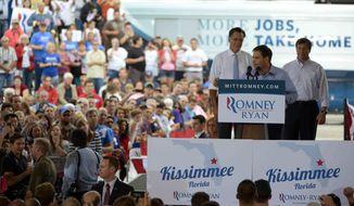 Sen. Marco Rubio, R-Fla., center, introduces Republican presidential candidate, former Massachusetts Gov. Mitt Romney, left, as Republican U.S. Senate candidate Connie Mack, listens during the Romney Ryan Victory Rally in Kissimmee, Fla., Saturday, Oct. 27, 2012. (AP Photo/Phelan M. Ebenhack)