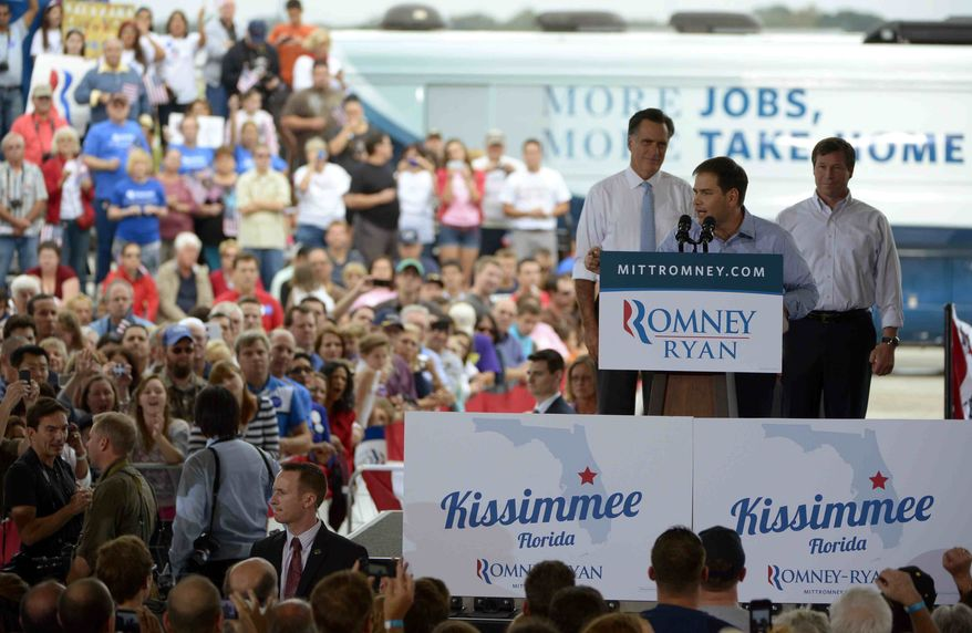 Sen. Marco Rubio, R-Fla., center, introduces Republican presidential candidate, former Massachusetts Gov. Mitt Romney, left, as Republican U.S. Senate candidate Connie Mack, listens during the Romney Ryan Victory Rally in Kissimmee, Fla., Saturday, Oct. 27, 2012. (AP Photo/Phelan M. Ebenhack)