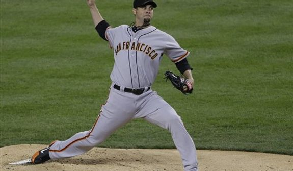 San Francisco Giants' Ryan Vogelsong throws during the first inning of Game 3 of baseball's World Series against the Detroit Tigers Saturday, Oct. 27, 2012, in Detroit. (AP Photo/Patrick Semansky)