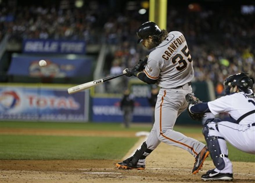 San Francisco Giants' Brandon Crawford hits during the second inning of Game 3 of baseball's World Series against the Detroit Tigers Saturday, Oct. 27, 2012, in Detroit. (AP Photo/Matt Slocum)