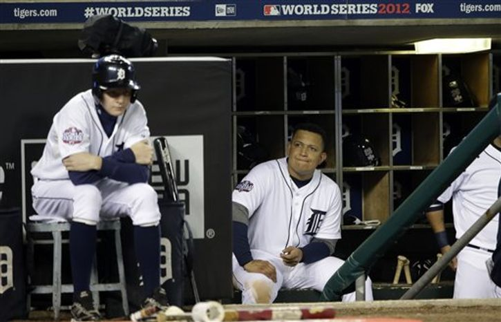Detroit Tigers' Miguel Cabrera watches from the dugout during the ninth inning of Game 3 of baseball's World Series against the San Francisco Giants Saturday, Oct. 27, 2012, in Detroit. (AP Photo/David J. Phillip)