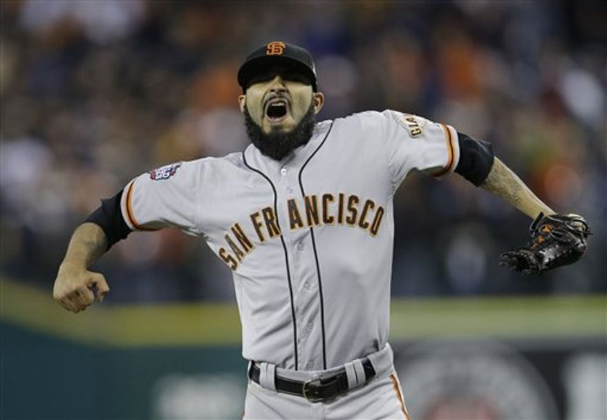 San Francisco Giants' Sergio Romo reacts after striking out Detroit Tigers' Omar Infante to end Game 3 of baseball's World Series Saturday, Oct. 27, 2012, in Detroit. The Giants defeated the Tigers 2-0. The Giants lead the series 3-0.  (AP Photo/Matt Slocum)