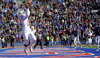 Texas tight end D.J. Grant catches the game-winning touchdown late in the second half of their 21-17 win over Kansas in an NCAA football game, Saturday, Oct. 27,2 012, in Lawrence, Kansas. (AP Photo/The Daily Texan, Elisabeth Dillon)