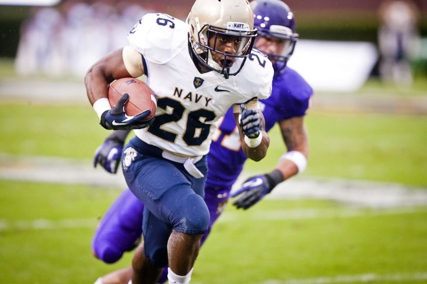 Navy's Marcus Thomas (26) rushes for a big gain during the first half against East Carolina in an NCAA college football game Saturday, Oct. 27, 2012, in Greenville, N.C. Navy won 56-28. (AP Photo/The Daily Reflector, Rob Taylor)
