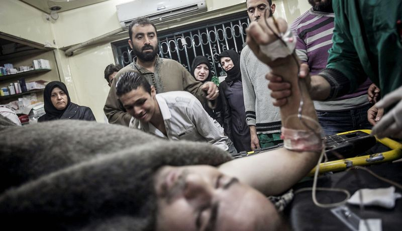 A Syrian civilian sobs as a relative lies on a hospital trolley after was he was wounded by a sniper shot to his back in Aleppo, Syria, on Saturday. A U.N.-backed truce declared for the Muslim holiday of Eid al-Adha has failed to take hold. (Associated Press)