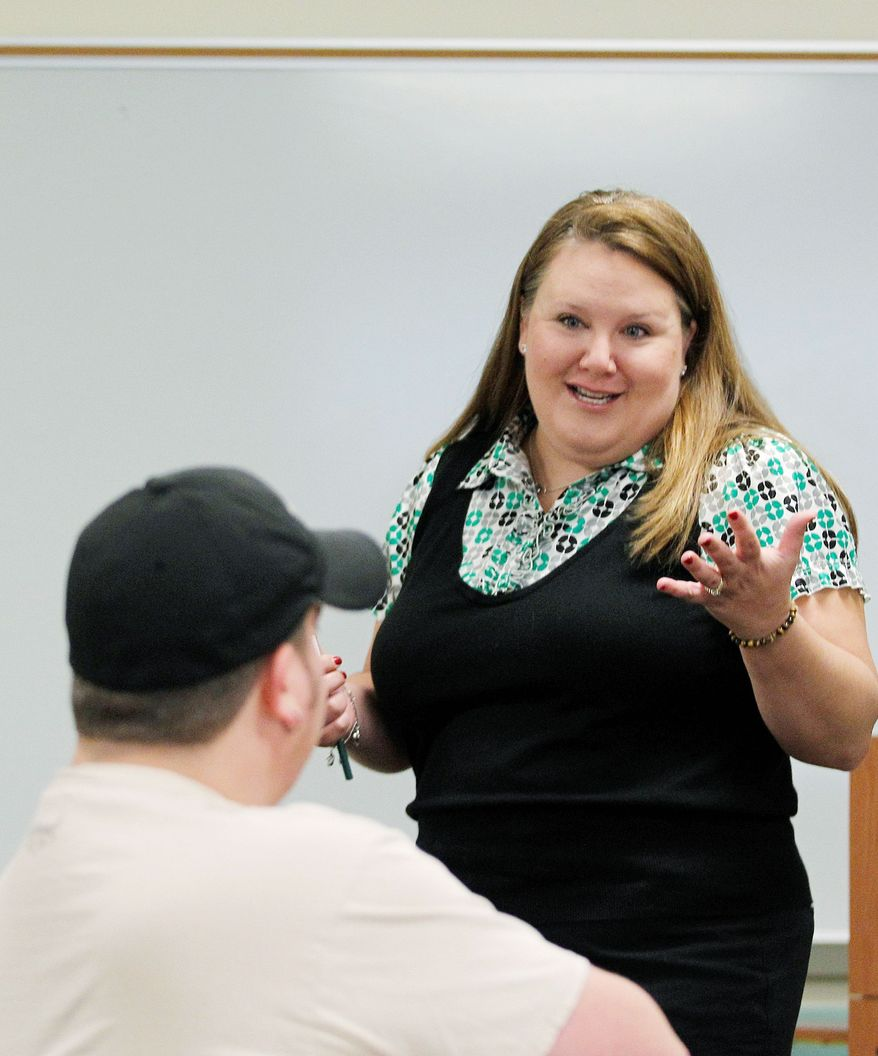 Professor Meredith Richards Martin lectures as a Navy veteran listens during a history class at Collin College in Frisco, Texas, earlier this month. Colleges are starting to offer veterans-only classes that cater to populations that tend to be older and more experienced. (Associated Press)