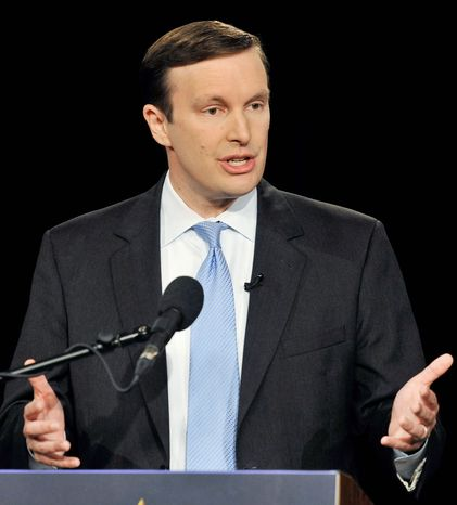 Democratic candidate, U.S. Rep. Christopher S. Murphy, Connecticut Democrat, makes his case during a debate against Republican candidate for U.S. Senate Linda McMahon in Hartford. The two are vying for the seat of retiring Joe Lieberman. (Associated Press)