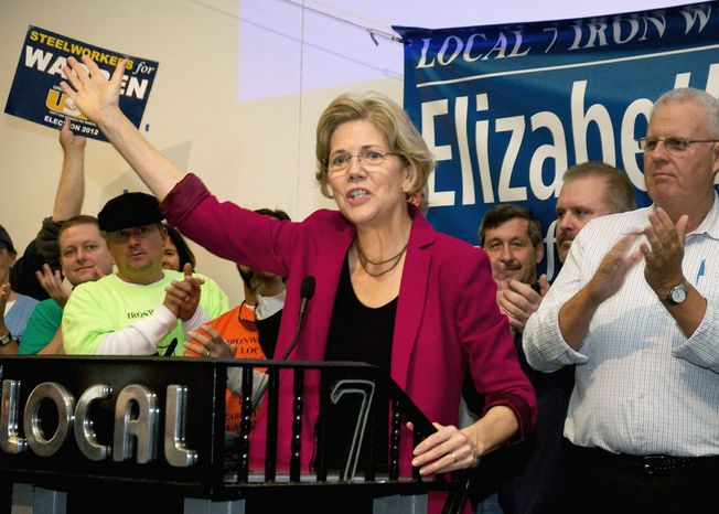 Senate candidate Elizabeth Warren speaks Saturday in Boston. Ms. Warren is running against Republican incumbent Sen. Scott P. Brown, who is now considered the underdog because she has linked him with Republican goals for a Democratic state. (Boston Herald via Associated Press)