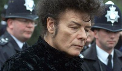 ** FILE ** British performer Gary Glitter gives a press conference in London in 2000. (AP Photo/Alastair Grant)