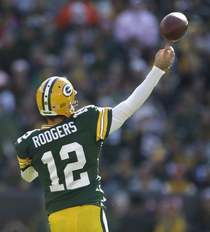Green Bay Packers' Aaron Rodgers throws in the first half of an NFL football game against the Jacksonville Jaguars Sunday, Oct. 28, 2012, in Green Bay, Wis. (AP Photo/Jeffrey Phelps)