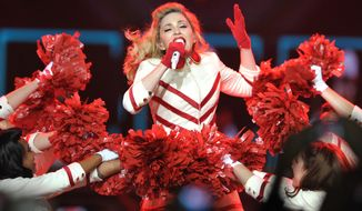 """** FILE ** Madonna performs on her """"MDNA"""" tour at the Staples Center in Los Angeles on Wednesday, Oct. 10, 2012. (John Shearer/Invision/AP)"""