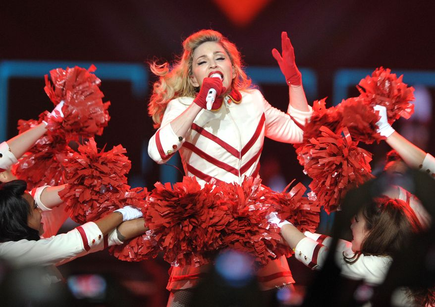 "** FILE ** Madonna performs on her ""MDNA"" tour at the Staples Center in Los Angeles on Wednesday, Oct. 10, 2012. (John Shearer/Invision/AP)"