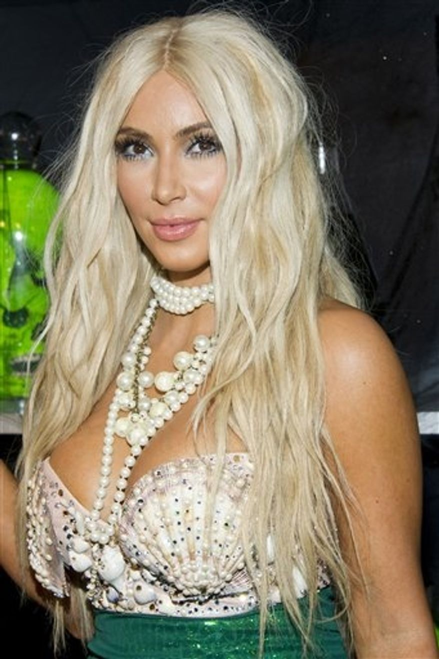 Kim Kardashian hosts the 2nd Annual Midori Green Halloween Party on Saturday, Oct. 27, 2012, in New York. (Photo by Charles Sykes/Invision/AP)