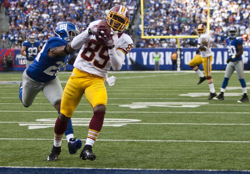 Washington Redskins wide receiver Santana Moss (89) catches a 30 yard touchdown pass from quarterback Robert Griffin III (10) in the forth quarter against the New York Giants at Metlife Stadium, East Rutherford, N.J., Oct. 21, 2012 (Craig Bisacre/The Washington Times)