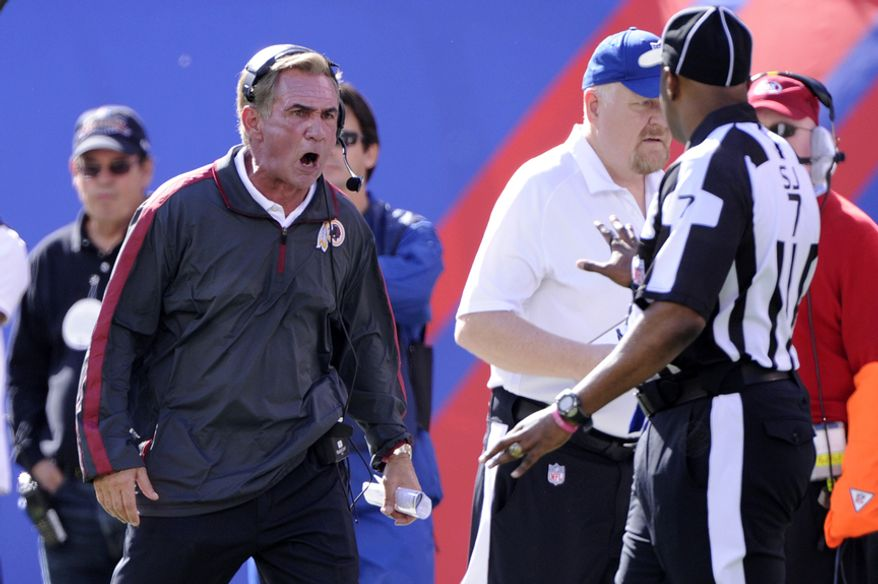 Washington Redskins head coach Mike Shanahan yells at Side Judge Keith Washington during a break in action in the first quarter at MetLife Stadium, East Rutherford, N.J., Oct. 21, 2012. (Preston Keres/Special to The Washington Times)