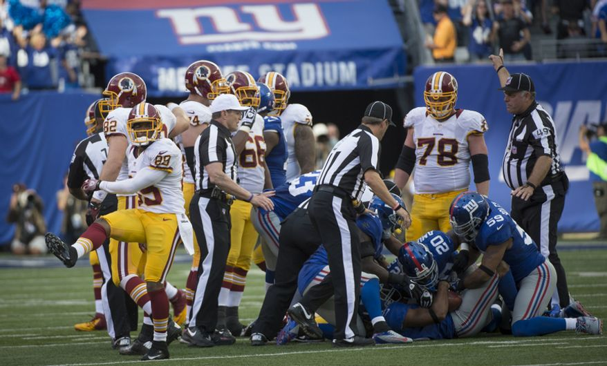 Washington Redskins wide receiver Santana Moss (89) kicks up his foot as he reacts to his fumble which is recovered by the New York Giants fourth quarter at MetLife Stadium in East Rutherford, N.J., Sunday, Oct. 21, 2012. (Rod Lamkey Jr./The Washington Times)
