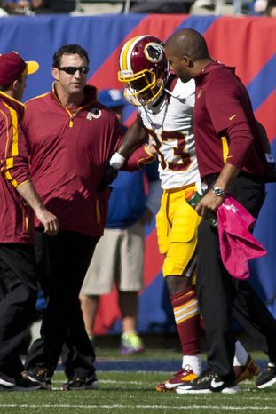 Washington Redskins tight end Fred Davis (83) is taken off the field in the first half against the New York Giants at Metlife Stadium, East Rutherford, N.J., Oct. 21, 2012 (Craig Bisacre/The Washington Times)