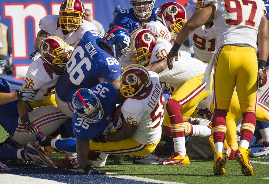 New York Giants running back Andre Brown (35) scores for a touchdown in the second quarter at MetLife Stadium in East Rutherford, N.J., Sunday, Oct. 21, 2012. (Rod Lamkey Jr./The Washington Times)