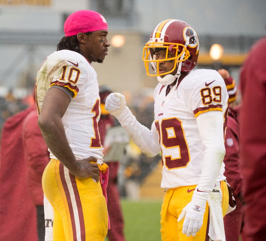 Washington Redskins quarterback Robert Griffin III (10) and Washington Redskins wide receiver Santana Moss (89) stand together on the sideline towards the end of the game as the Washington Redskins  lose to the Pittsburgh Steelers 27-12 at Heinz Field, Pittsburgh, Pa., Sunday, October 28, 2012. (Andrew Harnik/The Washington Times)