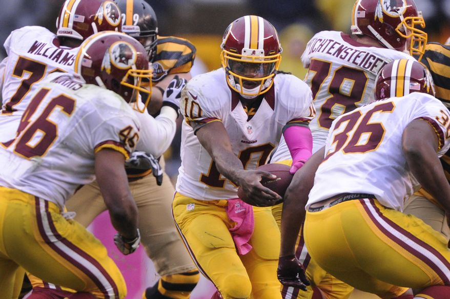 Washington Redskins quarterback Robert Griffin III (10) mishandles a handoff to running back Alfred Morris (46) causing a fumble in the third quarter which the Redskins' quarterback recovered at Heinz Field, Pittsburgh, Pa., Oct. 28, 2012. (Preston Keres/Special to The Washington Times)