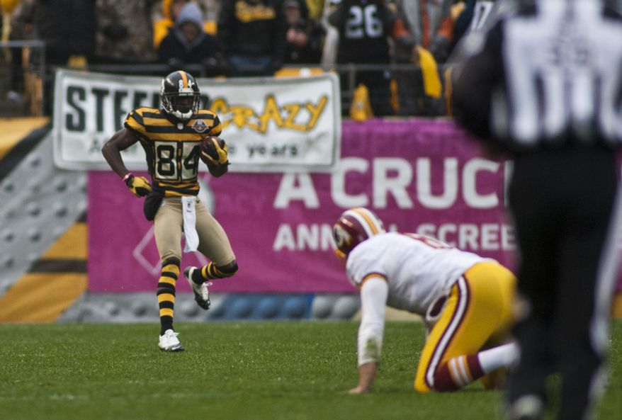 Pittsburgh Steelers wide receiver Antonio Brown (84) showboats as he runs backwards into the end zone on a 78 yard touchdown that was nullified by an illegal block in the back in the 3rd quarter as the Washington Redskins lose to the Pittsburgh Steelers 27-12 at Heinz Field, Pittsburgh, Pa., Sunday, October 28, 2012.  (Craig Bisacre/The Washington Times)