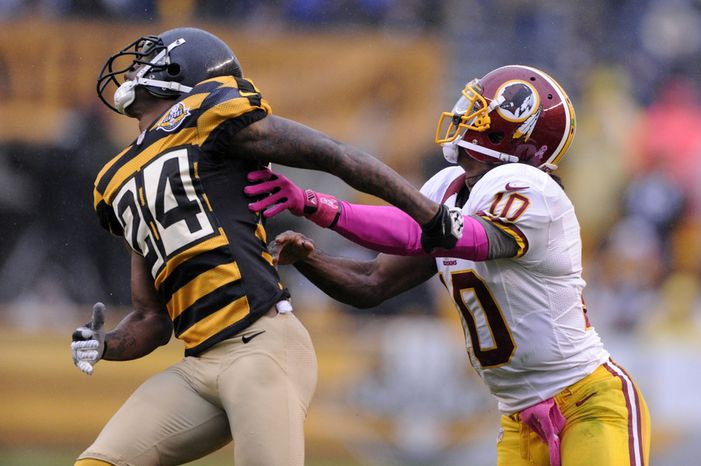 Washington Redskins quarterback Robert Griffin III (10) is called for offensive pass interference against Pittsburgh Steelers cornerback Ike Taylor (24) on this second quarter pass by wide receiver Josh Morgan at Heinz Field, Pittsburgh, Pa., Oct. 28, 2012. (Preston Keres/Special to The Washington Times)