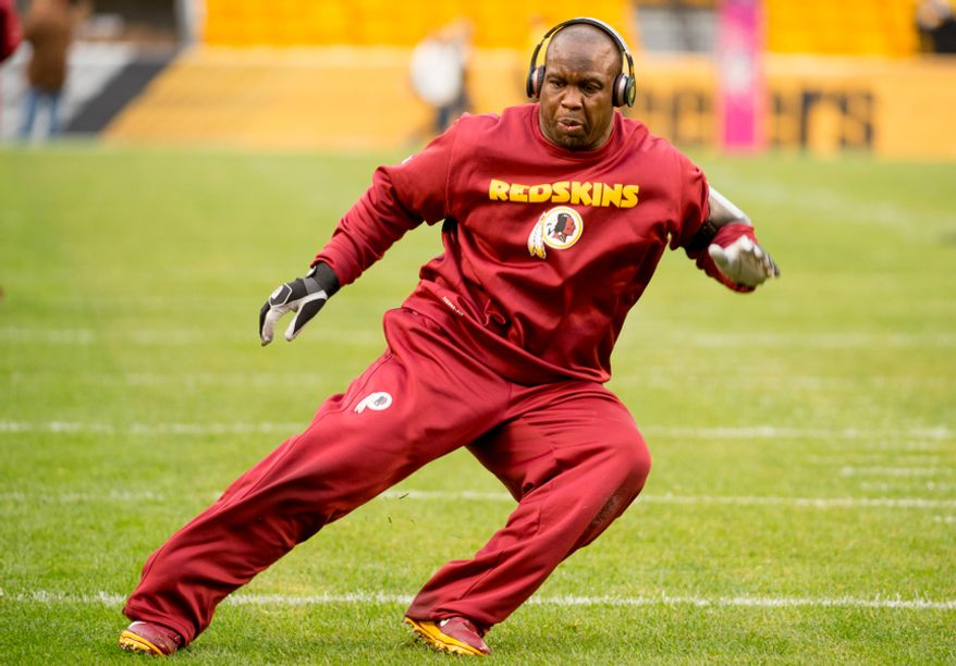 Washington Redskins inside linebacker London Fletcher (59) tests the hamstring he injured in last week's game against the New York Giants, as the Redskins warm up before they take on the Pittsburgh Steelers at Heinz Field in Pittsburgh on Sunday, Oct. 28, 2012. (Andrew Harnik/The Washington Times)