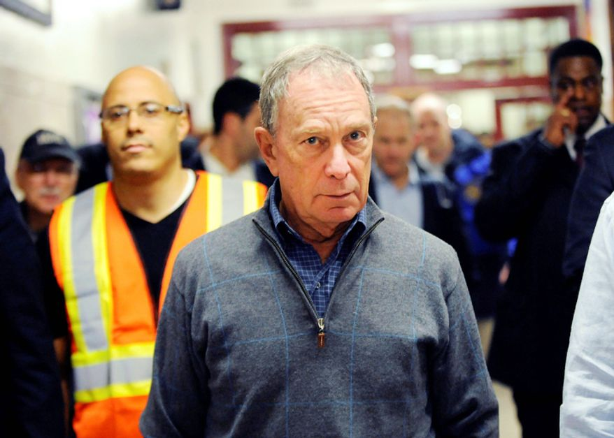 Mayor Michael Bloomberg arrives at Seward Park High School on the lower east side, the site of one of many public shelters set up in preparation of the storm, Sunday, Oct. 28, 2012, in New York.  (AP Photo/ Louis Lanzano)