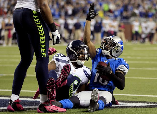 Detroit Lions wide receiver Titus Young (16) celebrates his winning touchdown reception against Seattle Seahawks cornerback Brandon Browner (39) in the end zone during the second half of an NFL football game, Sunday, Oct. 28, 2012. in Detroit. The Lions won 28-24. (AP Photo/Carlos Osorio)