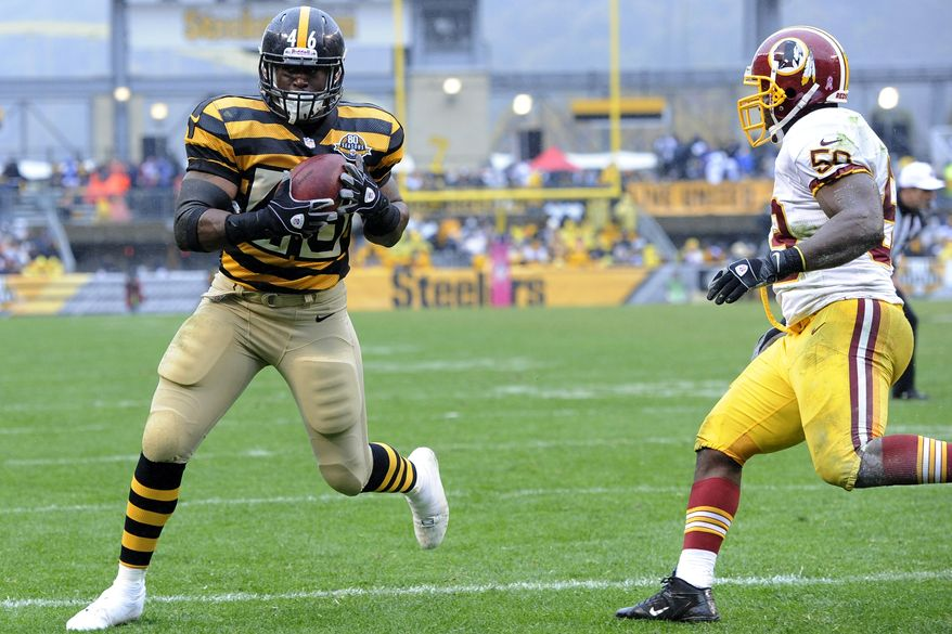 Pittsburgh Steelers fullback Will Johnson (46) makes a catch past Washington Redskins inside linebacker London Fletcher (59) for a touchdown in the third quarter of an NFL football game on Sunday, Oct. 28, 2012, in Pittsburgh. (AP Photo/Don Wright)